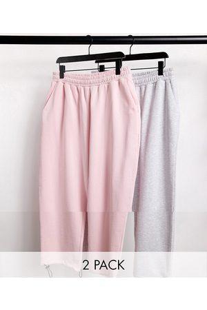 ASOS Confezione da 2 joggers super oversize rosa/bianco mélange con chiusura con alamari sull'orlo