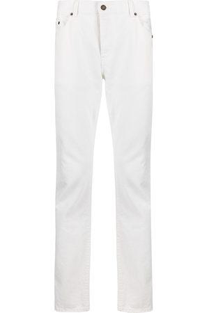Saint Laurent Jeans slim con effetto schiarito