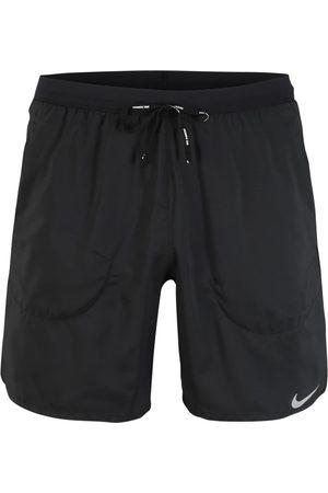 Nike Pantaloni sportivi 'Flex Stride' / chiaro