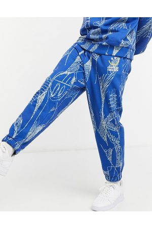 Crooked Tongues Joggers con stampa a fantasia in coordinato