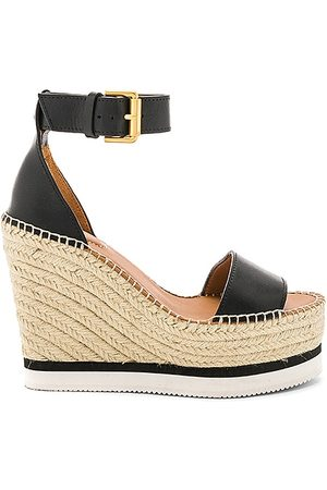 See by Chloé Glyn Wedge Sandal in - Black. Size 36 (also in 37, 38, 39, 40, 41).