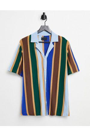 ASOS Polo in maglia a righe verticali con rever