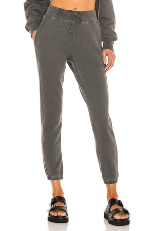 NSF Sayde Slouchy Slim Sweatpant in - Black. Size L (also in M, S, XS).