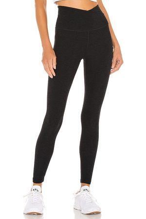Beyond Yoga Donna Leggings & Treggings - Spacedye At Your Leisure High Waisted Midi Legging in - Black. Size M (also in XS, S).