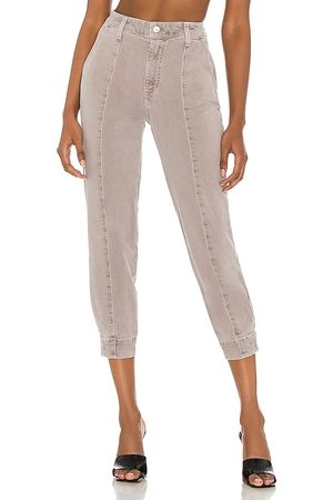 LE JEAN Mid Rise Paloma Jogger in - Tan. Size 23 (also in 24, 25, 26, 27, 28, 29, 30, 31, 32).