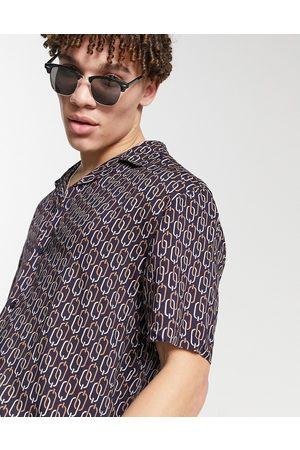 River Island Camicia nera a maniche corte con stampa di catene
