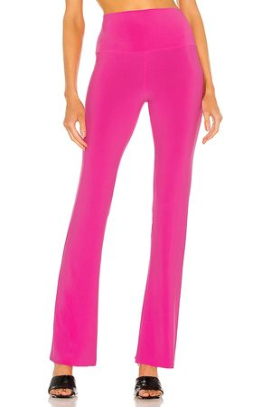 Norma Kamali X REVOLVE Boot Pant in - Pink. Size L (also in XS, S, M).