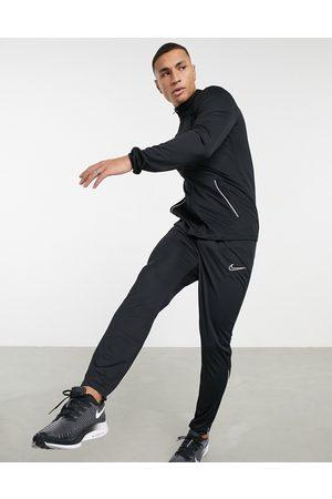 Nike Academy - Tuta sportiva nera e bianca