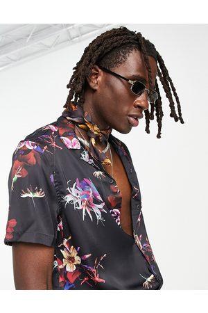 ASOS Camicia comoda in raso con rever e stampa floreale su base nera
