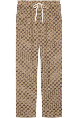 Gucci Uomo Di pelle - Pantalone in tessuto GG con GG in pelle