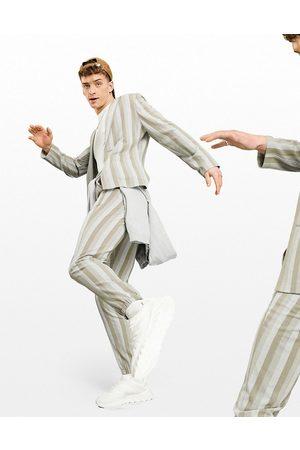 ASOS Pantaloni da abito skinny casual in seersucker a righe con elastico sul fondo, colore écru-Neutro