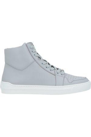 VERSACE Uomo Sneakers - CALZATURE - Sneakers & Tennis shoes alte