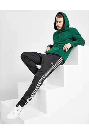 adidas Uomo Pantaloni sportivi - SST Tracksuit Bottoms