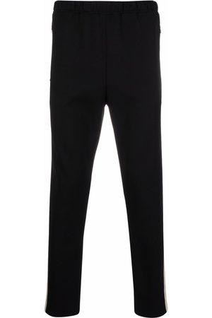 Alexander McQueen Pantaloni sportivi con banda laterale