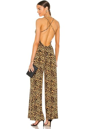 Norma Kamali X REVOLVE Low Back Slip Jumpsuit in - Brown. Size L (also in XS, XXS, S, M).