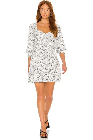 FAITHFULL THE BRAND X REVOLVE Arianne Mini Dress in - White. Size L (also in XS, S, M, XL).