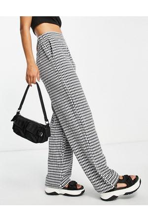 Pieces Pantaloni a fondo ampio neri a quadretti