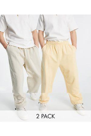 ASOS Confezione da 2 joggers super oversize in tessuto organico avena mélange/arancione pastello con fermacorda sul fondo