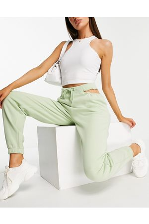 ASOS Joggers oversize con cut-out in vita