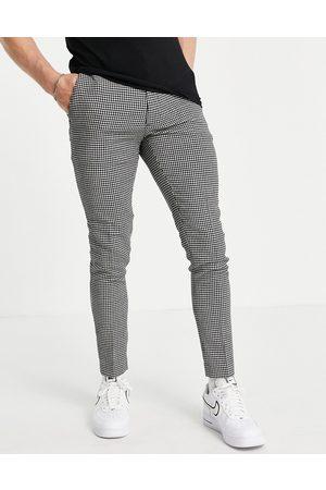ASOS Pantaloni super skinny eleganti in misto lana neri con motivo pied de poule