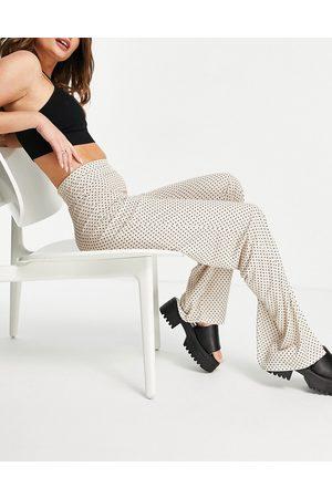 ASOS Pantaloni a vita alta con fondo ampio in mussola color crema a piccoli pois