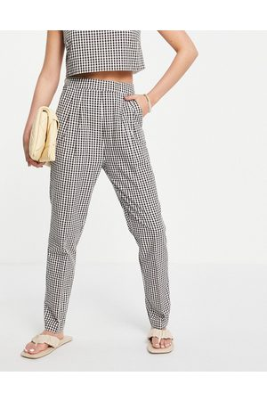 ASOS Pantaloni con etichetta laterale a quadretti in coordinato