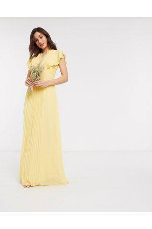 TFNC Vestito lungo da damigella con maniche a volant e dettagli in pizzo limone