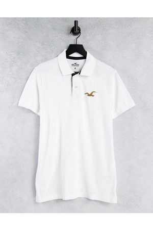 Hollister Polo slim bianca in piqué con logo con icona rifrangente