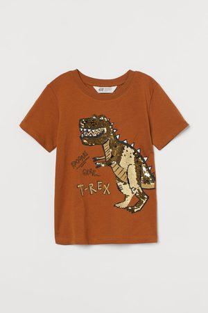 H&M T-shirt paillettes reversibili