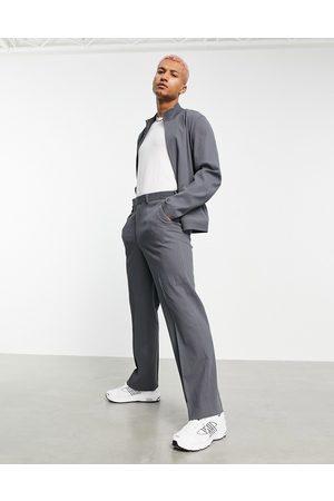 ASOS Pantaloni eleganti a fondo ampio in tessuto stropicciato in coordinato