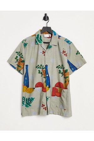 ASOS DESIGN Camicia con stampa di frutta e colletto rever vestibilità classica lavaggio vintage