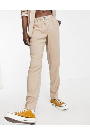 ASOS DESIGN Pantaloni del pigiama stile abito slim cammello con profili-Neutro