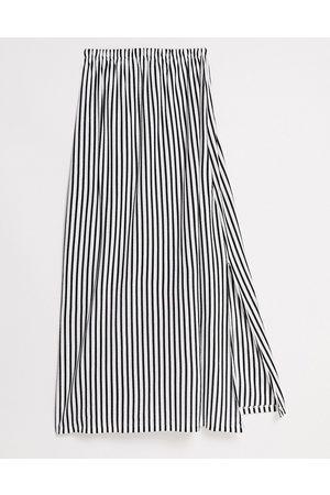 ASOS DESIGN Prendisole a fascia lungo con tasche a righe, monocromatico