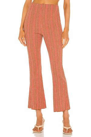 Free People Fine Line Slim Pant in - Rust. Size L (also in XS, S, M, XL).