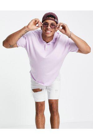 ASOS DESIGN T-shirt oversize con collo a polo in maglia lilla