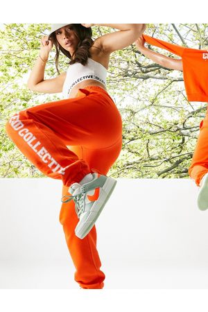 ASOS ASOS - Weekend Collective - Joggers oversize arancioni con stampa stile college