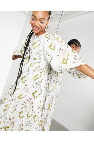 ASOS Donna Vestiti da sera - Vestito grembiule a balze con maniche a sbuffo in pizzo stampato