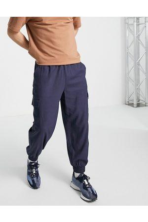 ASOS Pantaloni oversize affusolati in misto lino navy con tasche cargo