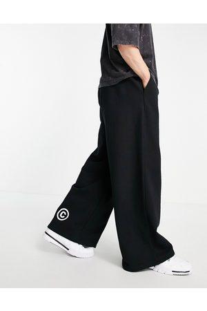 ASOS Dark Future Joggers oversize pesanti a fondo ampio neri con stampa del logo
