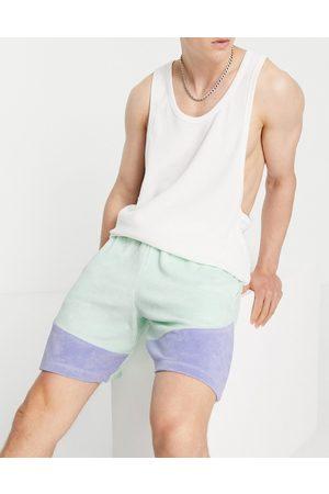 ASOS DESIGN Pantaloncini oversize in spugna blu color block in coordinato