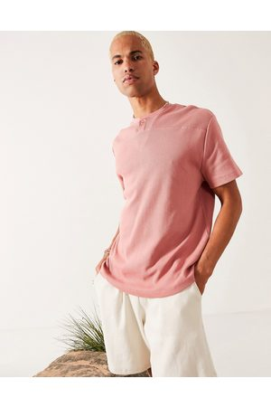 ASOS T-shirt comoda a maniche corte con collo serafino e lavorazione a nido d'ape