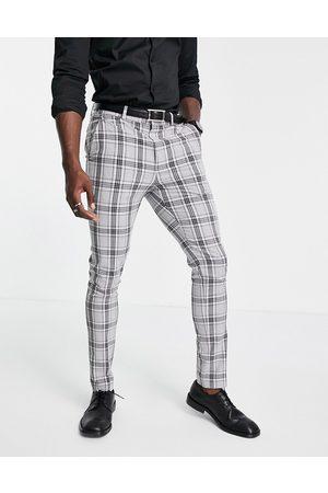 ASOS DESIGN Pantaloni da abito skinny in tessuto a quadri Principe di Galles grigi