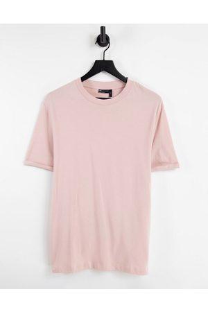 ASOS DESIGN T-shirt in tessuto organico con risvolto sulle maniche pallido