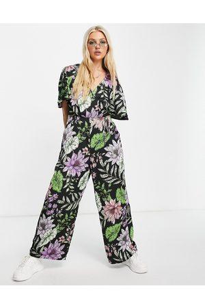 Liquorish Tuta jumpsuit a portafoglio con stampa di fiori tropicali