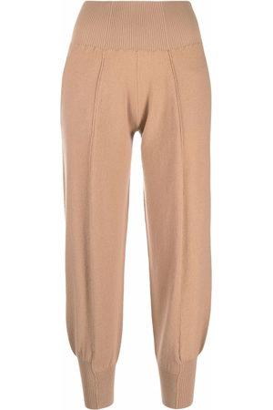 Stella McCartney Donna T-shirt sportive - Pantaloni sportivi affusolati - Toni neutri