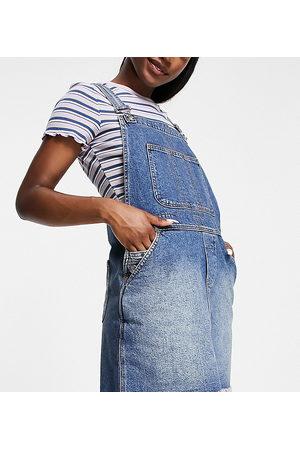 Reclaimed Vintage Inspired - Salopette di jeans lavaggio authentic con minigonna