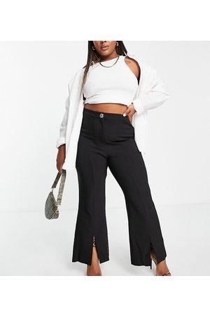 River Island Donna Leggings & Treggings - Pantaloni a zampa sartoriali neri con spacco sul davanti