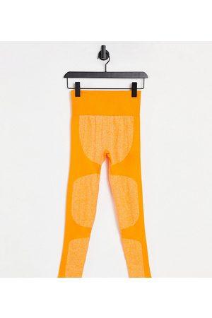 Love & Other Things Petite - Leggings sportivi senza cuciture con dettagli a contrasto color mandarino
