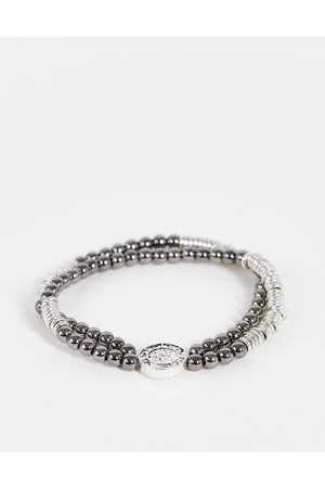 Icon Brand Bracciale elasticizzato con perline e moneta