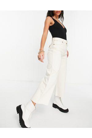 Wrangler Jeans corti a vita alta con fondo ampio écru